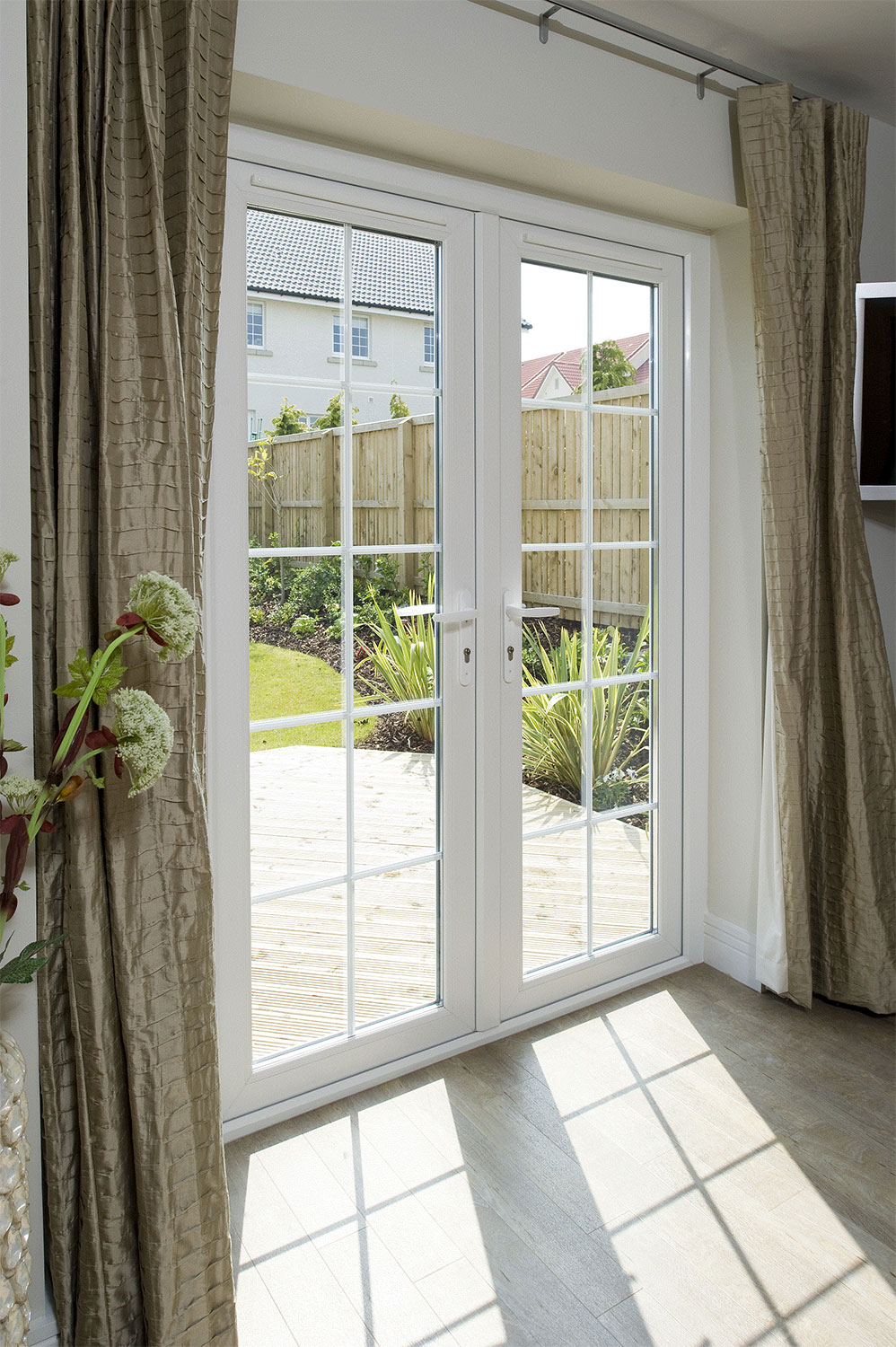 French doors windowmate upvc home improvements for Upvc french doors with letterbox