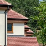 Oak_Fascia_and_Black_Guttering.jpg...